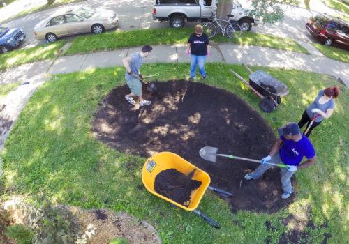 Overhead view of volunteers installing a raingarden.